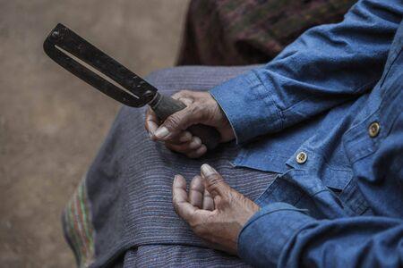 paring knife: Vintage filter : Old women holding her paring knife Stock Photo