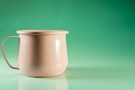 green tone: Pink Zinc Cup on Vintage Green  Tone Background