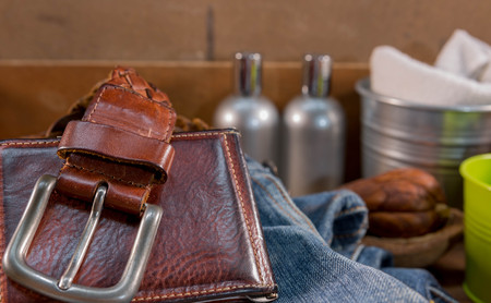 leather belt: Vintage Filter : Male  Leather belt and wallet on jeans  in wood box