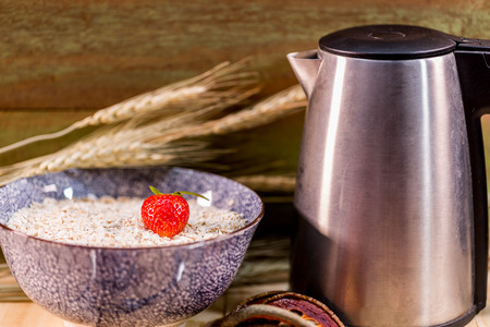 hot pot: Strawburry in malt serial with hot pot on wood background Stock Photo