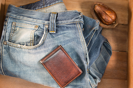 checkered polo shirt: Vintage Filter : Male jeans and wallet in wood box