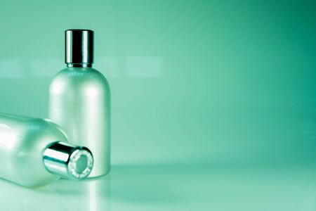 green tone: Green Tone and Side View : Two aluminium bottles Stock Photo
