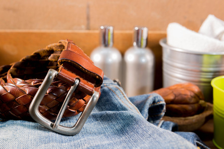 checkered polo shirt: Vintage Filter : Male  Leather belt on jeans  in wood box Stock Photo