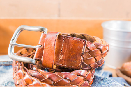 Vintage Filter : Male  Leather belt on jeans  in wood box Stock Photo