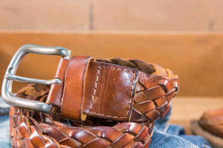 leather belt: Vintage Filter : Male  Leather belt on jeans  in wood box Stock Photo