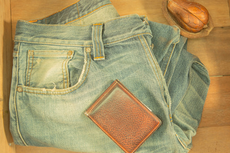 Vintage yellow tone Filter : Male jeans and wallet in wood box