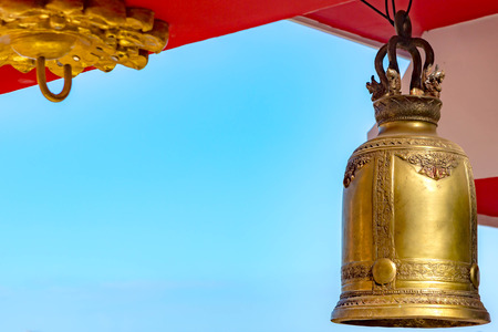 peal: Shimmery Golden bell, in public temple - thailand Stock Photo