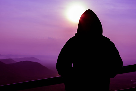 ie: Soft of Focus and Silhouette of young man on Senrise Top View at Pha Mor Ie Deang , Srisaket ,Thailand Stock Photo