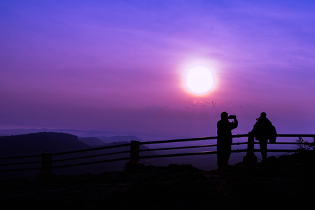taking a wife: Silhouette Filter and Soft of Focus : Man is taking photos of his wife on sunrise landscape background