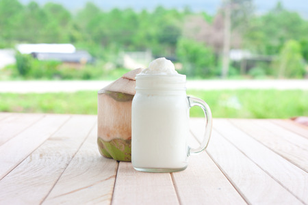 coconut milk smoothie on a wooden table