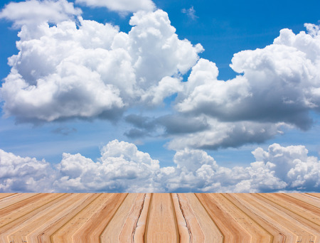 table top: Wood table top on blue sky background Stock Photo