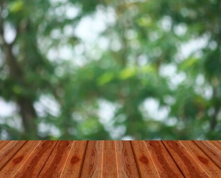 Wood table top on bokeh abstract background - can be used for montage or display your products Banco de Imagens