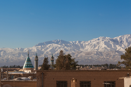 View of old Kachan city,Iran, with the snow covered mountain range in background in the clear blue sky day Zdjęcie Seryjne