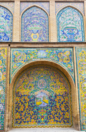Tehran,Iran-Feb 11,2017;Exterior colorful decoration painting mosaic on the wall at Golestan palace;a UNESCO world heritage site,the oldest group of buildings in tehran