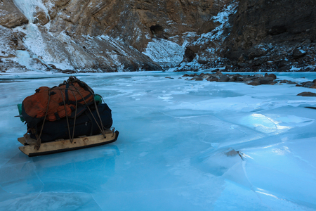 Sled carry Camping equipment on the surface of frozen Zanskar river for chadar trek in winter in Leh,Ladakh,Jammu and Kashmir,India