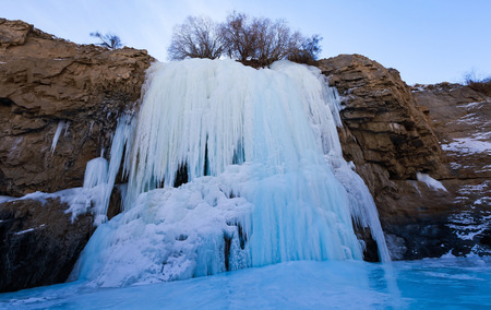 Frozen waterfall on the way of Chadar trek (The frozen Zanskar river trekking) during winter in Leh,Ladakh,India.