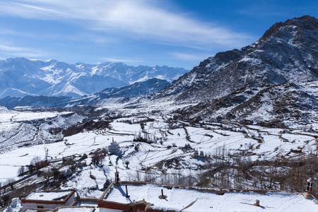 Top view of village covered with snow and himalaya mountain range in background during winter,Leh,Ladakh,Kashmir,India