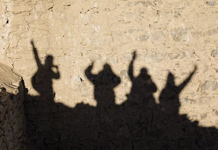 Shadow of four happy tourists on the brick wall in Leh,Ladakh,Kashmir,India Zdjęcie Seryjne