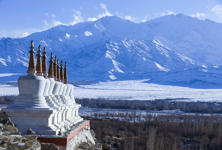 Eight tibetan stupas with himalaya mountain range in bachground during winter in Leh,Ladakh,Kashmir,India