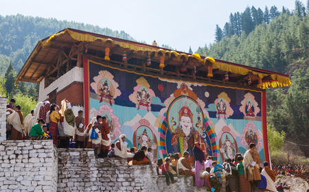 Paro,Bhutan-Apr 4,2015;Thongdroel(liberation on sight) of Guru Rinpoche hanging in Rinpung Dzong(fortress) during Paro Tshechu(festival) in order to confer blessings on Bhutanese assembled.