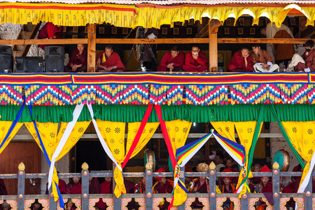 Paro,Bhutan-Apr 4,2015;Group of Buddhist lamas play tibetan music instruments for the mask dance at Rinpung Dzong during Paro Tshechu