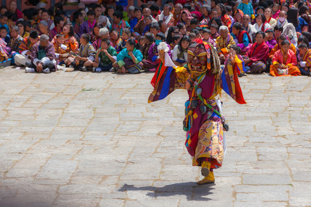 Paro,Bhutan-Apr 4,2015;Buddhist lama performs mask dance in front of Bhutanese people in beautiful traditional costume at Rinpung Dzong during Paro Tshechu