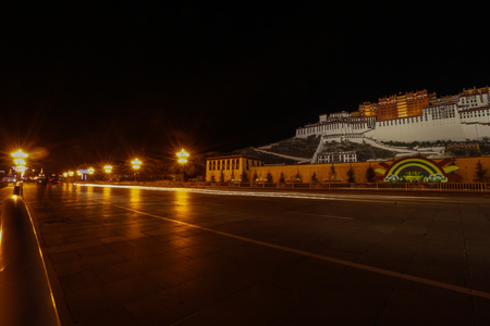 Night scenery of Potala palace with road light lamps decoration and black background,Tibet,China