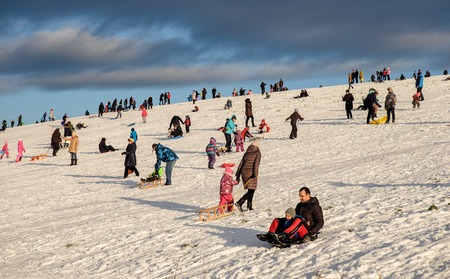 Riga, Latvia - December 4, 2016 - Snow sledding hill in Riga is joy for children and adults. This weekend first opening for public by Nil Ushakov, the mayor of the city Editorial