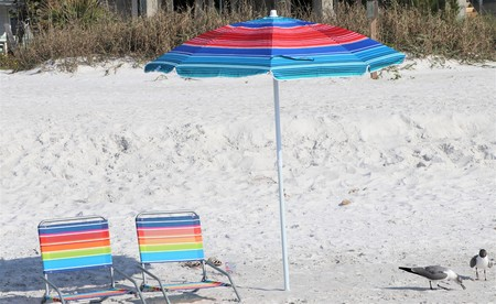 secluded beach chairs and umbrella on the sandy beaches of Florida Stock fotó