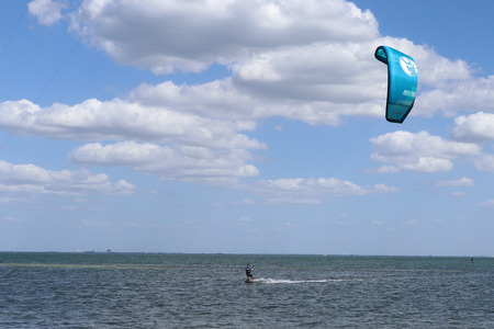 Kite surfing in Tampa Bay in front of the skyway bridge