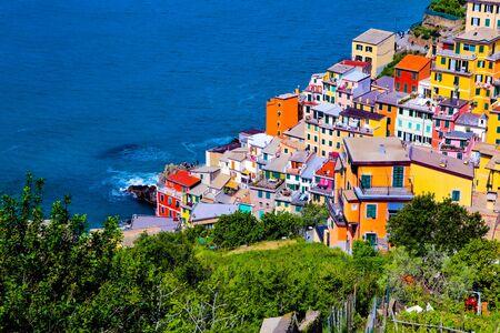 coastal view of Cinque Terre, the Riomaggiore village which is a small village in the Liguria region of Italy.