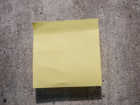 cork sheet: yellow reminder sticky note on wall
