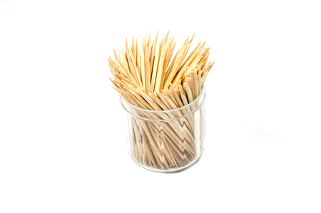 dozen: Wooden toothpick in the dozen plastic on the white backgroud Stock Photo