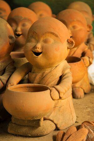 stucco: handicraft monk stucco Stock Photo