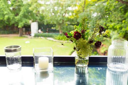 glass jar: flower in glass jar with bokeh background