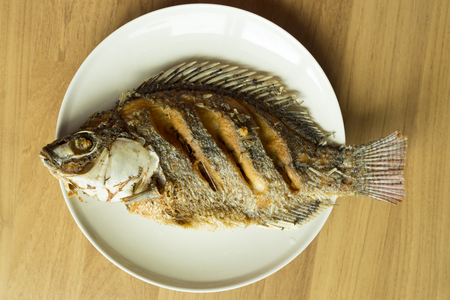 niloticus: Nile tilapia or Oreochromis niloticus  fry on dish Stock Photo
