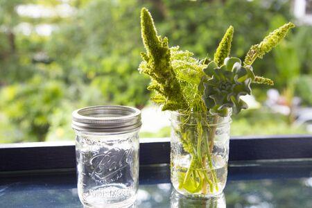 glass jar: flowers in glass jar with bokeh background