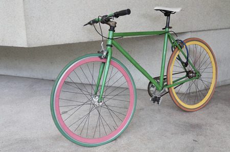 green fixed gear bicycle at building