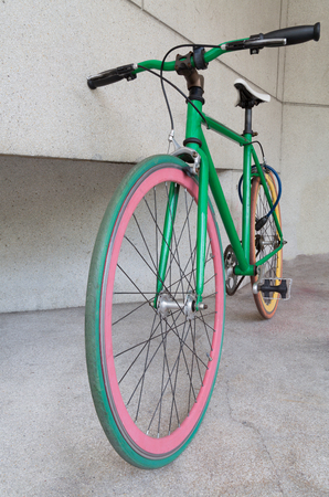 fixed: green fixed gear bicycle at building