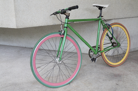 green fixed gear bicycle at building photo