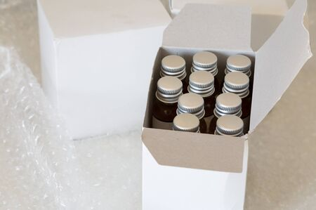 polyethylene film: Medicine bottles in white paper box and air bubble Stock Photo