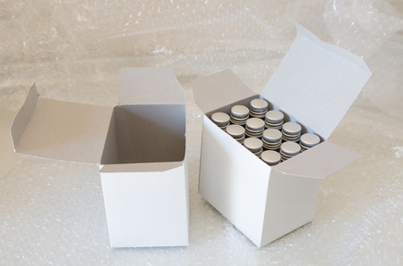 medicine bottles: Medicine bottles in white paper box and air bubble Stock Photo