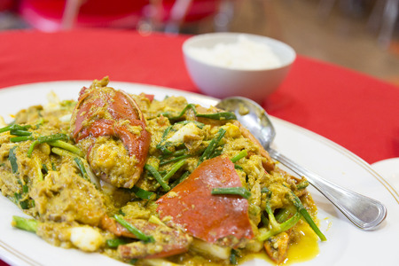 aquatic herb: Fried crab in yellow curry or Stir-fried crab curry power  on red background