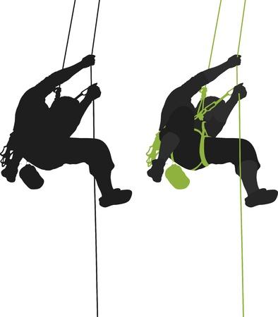 Rock climber silhouette suspendue