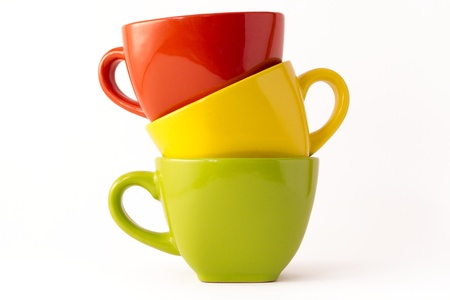 Iridescent coffee cups on a white background photo