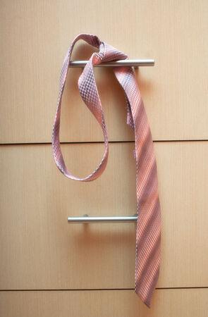 checkroom: necktie in the locker room