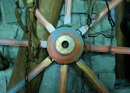 Ancient vintage wooden wheel in the stable