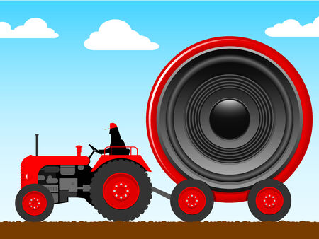 old tractor: Tractor pulling a huge speaker