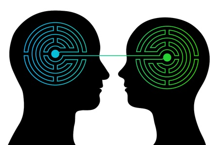 feelings and emotions: head silhouettes of a couple with a labyrinth inside their heads showing the complexity of the human brain and emotions with an interconnecting line between their heads, complex communication