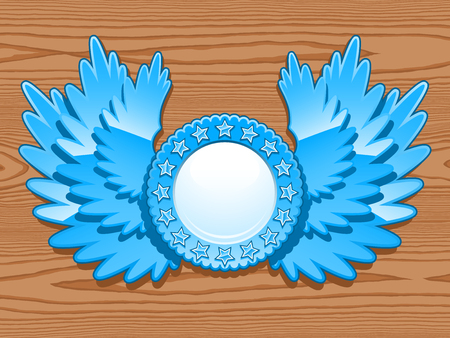 Decorative blue winged circular crest with blank central white copy space over a wooden background with woodgrain, vector illustration for heraldry themed concepts Stock Photo